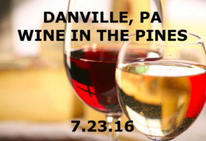 closeup of 2 wine glasses - 1 with red, 1 with white wine Text: Danville PA Wine in the Pines