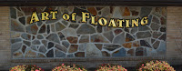 wall of brown, gray, black irregular shaped stones with 4 brown bushes below and gold text: Art of Floating