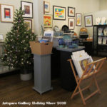 Artspace Gallery Holiday Show 2016 with Christmas tree, art displayed on walls and shelves