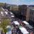Crowds & white tents on main street at Bloomsburg Renaissance Jamboree