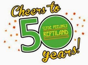 "Poster with yellow text outlined in black ""Cheers to 50 Years"", 50 large green numbers outlined in black"