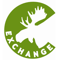 Circular spring green logo with white silhouette of moose head on right and white text around lower edge: Exchange