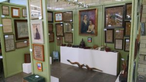 display of art & needlepoint at Bloomsburg Antiques Show and Sale Photo by RSG Antiques and Productions