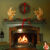 red brick fireplace with green mantel and wall Christmas wreath above with red bow 2 gold angels on mantel