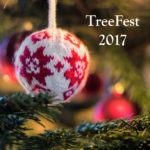 White yarn Christmas ball with red snowflake pattern hanging in foreground, lighted evergreen Christmas tree in background Text – TreeFest 2017