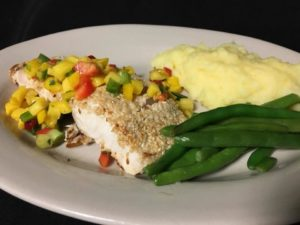 MahiMahi with salsa green beans and mashed potatoes on white plate