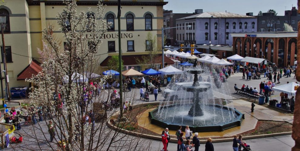 birds eye view of fountain gushing water on Center Street of Bloomsburg during the renaissance jamboree as people gather in the streets to enjoy