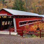East & West Paden Covered Bridges - two red bridges with white trim end to end over stream