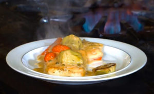Chilean Sea Bass with artichokes and tomatoes in Limoncello Cream Sauce