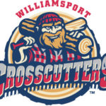 Williamsport Crosscutters logo: Bearded woodsman with red checked cap and shirt, log on one shoulder, bat on other