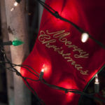 Red Christmas Stocking with 'Merry Christmas' embroidery & Christmas lights in front