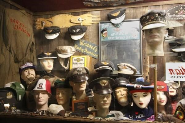 display case of collectibles-military hats