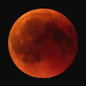 Red glow of Blood moon seen from Earth during lunar eclipse