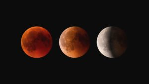 Three phases of lunar eclipse - red moon totality left lighter red middle phase partial eclipse right