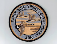 round emblem with three brown, black & white geese in flight Black text around edge: Early Bird Sports Expo 2016