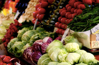 array of fresh vegetables displayed on farmers market
