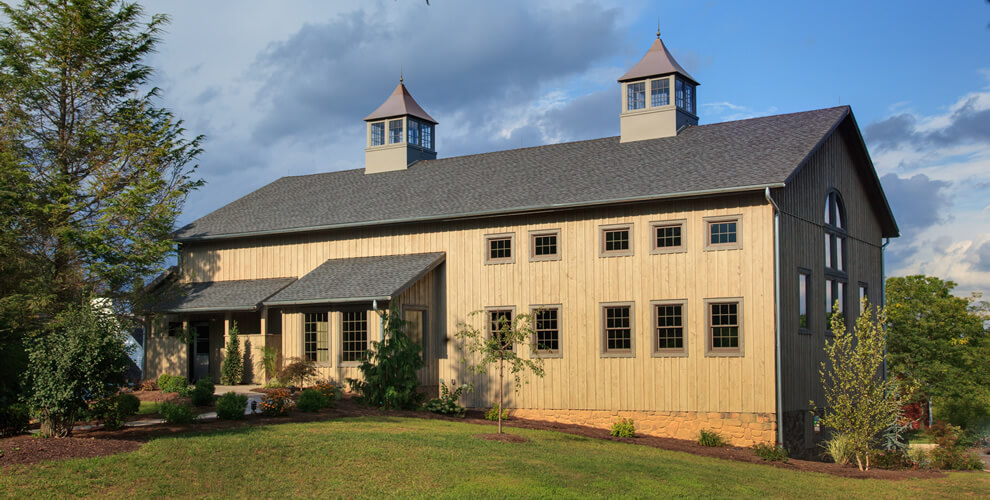 brewpub restaurant barn - brown vertical wood siding with windows and surrounded by greenery