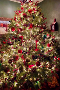 Christmas tree with red ornaments and white lights