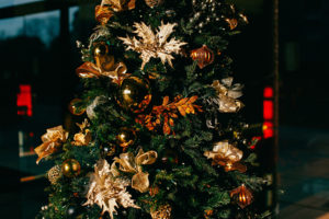 gold ornaments on christmas tree by Louis Magnotti https://unsplash.com/@lamagnotti