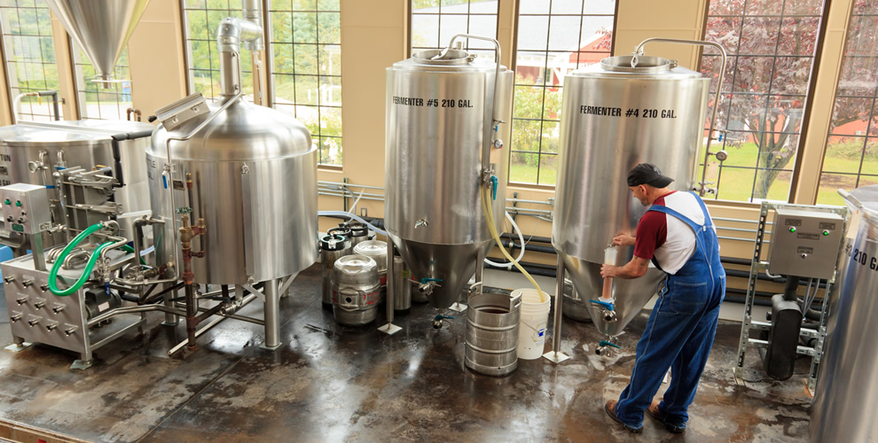 one of brewers working to make new beer with equipment in our onsite brewery