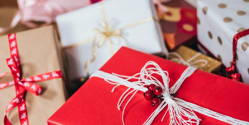 pile of gift packages wrapped in red and white papers with string ribbons