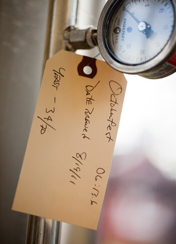 ticket label on measuring equipment of the brewery