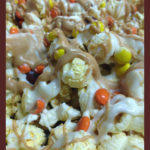 closeup of popcorn with milk & white chocolate drizzles and M&Ms
