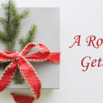 white gift box with red ribbon bow and pine sprigs text: A Romantic Getaway