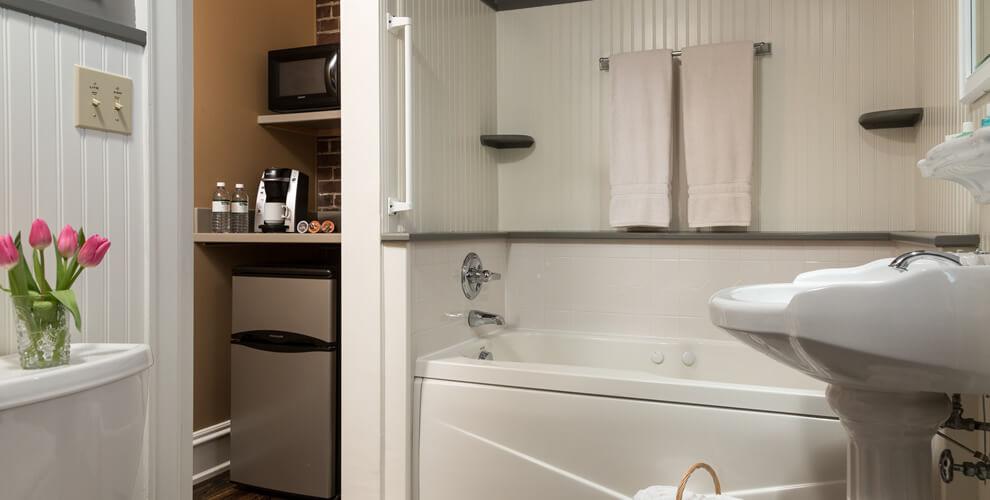 side view of white whirlpool bathtub