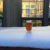 Glass of beer in snowdrift outside window of pub