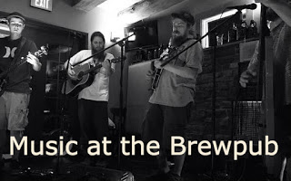 black and white - musicians performing for small concert at the Brewpub