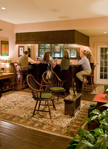 guests sitting at bar in our tavern at the farmhouse restaurant