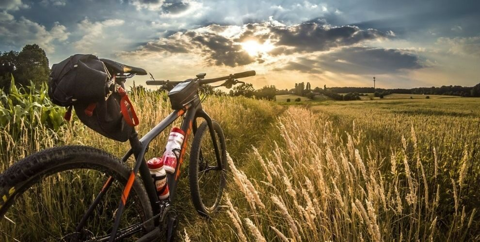Bike on grass looking at hills in distance
