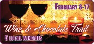 2 glasses red wine against white & gold snowflakes background text: wine and chocolate trail February 8 - 17, 2019
