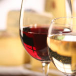closeup of white wine in glass and red wine in glass